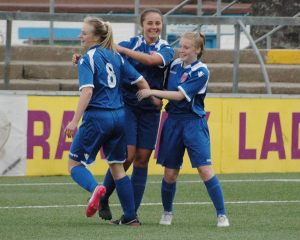 Dunbar, Johnstone and Gollan celebrate Dunbar's goal